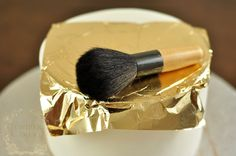 Step-by-step guide on adding edible gold leaf to a cake