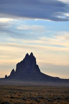 """Shiprock, New Mexico, Navajo Reservation. As a photograph, this falls under the """"Commercial/Landscape"""" category of the registry of Navajo photography. Shiprock, much like Window Rock, Arizona, is often photographed and viewed, but with little or no reference to the people (or the sheep!) that live there."""