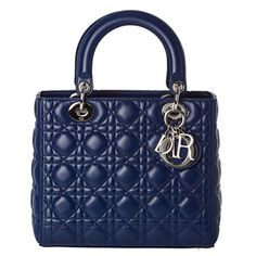 @Overstock.com - A bright blue, quilted leather construction highlights this designer Lady Dior tote bag by Christian Dior. A zippered closure and hanging logo charm in gleaming silvertone complete the high-fashion style of this carry-all.http://www.overstock.com/Clothing-Shoes/Christian-Dior-Lady-Dior-Medium-Blue-Leather-Tote-Bag/7499581/product.html?CID=214117 $2,599.99