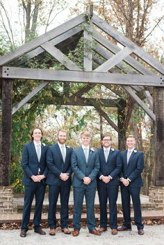 Dusty navy blue groomsmen suits. Wedding portrait at Cason's Cove in Bowling Green, KY. #photographybyloren #weddingphotography