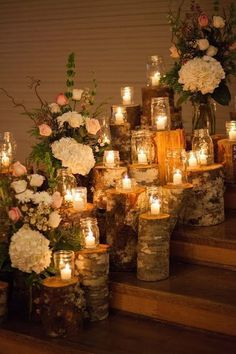 Incredible Wedding Decor Ideas for Your Ceremony Altar | Birch decorations create a dreamy look for a rustic wedding. Candlelit mason jars and floral arrangements, including hydrangeas and roses, illuminated birch logs for a stunning display on the stairway.