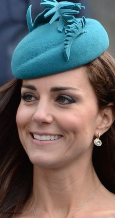 Kate's cute teal hat is by Jane Taylor. The Duchess wore her Kiki McDonough green amethyst earrings and a necklace with a silver chain. I personally love Kiki McDonough jewelry!