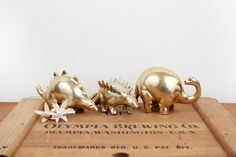 vintage brass set of three dinosaur figurines on Etsy, Sold Wooden Airplane, Nursery Themes, Themed Nursery, Kid Spaces, Making Ideas, Decorative Accessories, Baby Gifts, Place Card Holders, How To Make