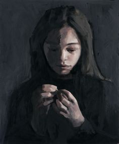 Girl in black looking at a ring, by Claerwen James.