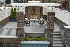 Outdoor rooftop fireplace and sitting area