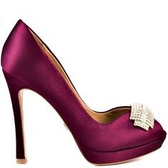 As you make your entrance in these sophisticated pumps, he'll feel like the luckiest guy in the world.  Badgley Mischka brings you an undeniably beautiful wine satin upper with an rhinestone encrusted brooch placed at the vamp.  This peep toe pump showcases a 4 1/4 inch stiletto heel and a 1/2 inch platform