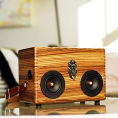 "Our brand new BoomCase - Handmade from rare solid Zebrawood and put together using a complicated ""finger joint"" this case marks our our first BoomCase made entirely from scratch. Available with the option to have it open and store things inside as well. Featuring a 50 Watt Amplifier with Bluetooth connectivity & two 4"" Copper Spiked Woofers"