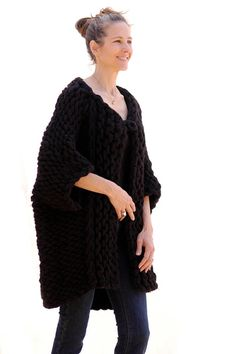 This oversized coat is made with 2 balls (125yds/115m each) of a new merino super chunky yarn called Bump from The BagSmith and a #50(25mm) needle.