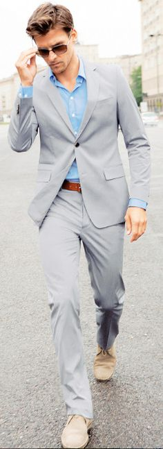 crushing. gray suit + brown-red belt + tan . . . chukkas, i think? . . . + simple blue man'blouse. well done. spare but VERY put together.