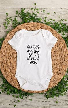Aunties Drinking Buddy baby bodysuit. This bodysuit is a perfect gift and sure to get a laugh.  *Bodysuits are Carter's brand. Please see their sizing chart if you aren't sure what size to order. *All bodysuits are white. The color you choose is for the text/image. *If you would like a colored