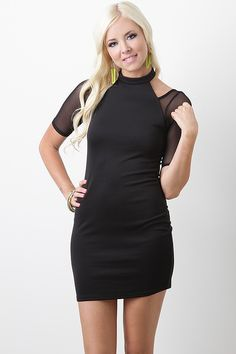 Dance the night away in this Midnight Cadence Dress! This dress features smooth stretch fabric, contrast semi-sheer mesh quarter sleeves, crew neckline with dual button closure at back, cutout shoulders, and finished with stitching detail. Accessories sold separately. Made in U.S.A. 100% Polyester. Contrast: 93% Nylon, 7% Spandex.