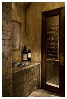 RUSTIC WINE CELLAR Distressed wood, walls. Granite counter top
