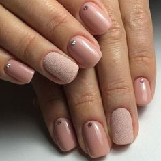 A really cute pink themed winter nail art design. The nails are painted in pink nail polish as well as a pink frosted nail polish, creating a simple yet unique nail art design, beads are also added on top for effect.