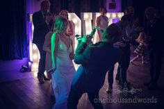 Musician plays to the bride from Italian Villa Wedding Photographs. Photography by one thousand words wedding photographers