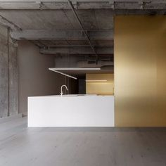 """""""Offering images evolving towards abstraction, this golden ribbon, containing domestic functions as storage units, breaks up space into a single operation of powerful efficiency,"""" - Jean Verville Architecte ⠀⠀ Fitout by : Photo by : Seen on ⠀⠀ Lobby Interior, Gold Interior, Restaurant Interior Design, Cafe Interior, Interior Lighting, Modern Interior Design, Kitchen Interior, Interior Architecture, Interior And Exterior"""