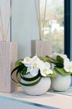 Orchids in a White Ceramic Vase