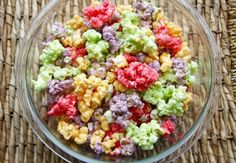 Kool-Aid Popcorn ~ Satisfy your taste buds with this flavorful popcorn treat!  This recipe used cherry, lemon-line, grape and orange flavored Kool-Aid.  What flavors will you choose?  Add this popcorn to paper cones or popcorn boxes for a fun snack or party favor.