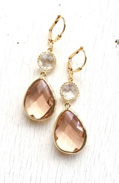 Champagne Peach and Clear Crystal Dangle Earrings. Wedding Bridesmaid Earrings. Bridesmaid Gift. Wedding Jewelry. Bridal Earrings. Gift.  These earrings are lovely and feminine and just stunning. The unique faceting on the champagne pendant is truly gorgeous.  The champagne glass teardrops are 21mm long. The earrings are about 2 long including the gold plated leverbacks.  Please dont hesitate to contact us if you need more than the number of pairs listed…
