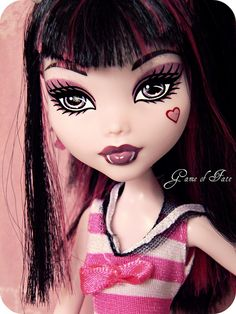 For Tiny. I have a shirt that would work... Maybe a white skirt over the fluffy black petticoat I have. Black and pink wig is a must. Then makeup is straight forward. Heart on cheek and white fangs are a must. Crazy Tights.