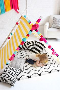 reading tent for kids - DIY with fabric, wood, and yarn to wrap the posts