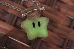 Glow-in-the-dark Super Mario Invincibility Star Necklace. $16.00, via Etsy.