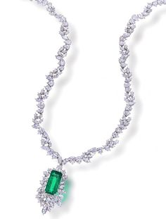 A Harry Winston necklace featuring a 13.45 ct. rectangular-cut Colombian emerald surrounded by an additional 32 cts. of diamonds sold for $230,500.