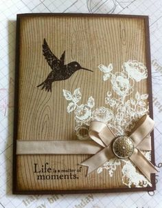 handmade card:  Wooden Hummingbird by LancasterLurker  ...  kraft base on brown card ... stamped woodgrain ... white embossed flower bouquet ... dark brown stamped hummigbird ... ribbon with metal button brad ... sweet card ... Stampin' Up!