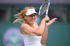 Maria Sharapova returns a shot from Arina Rodionova. - Jon Buckle/AELTC