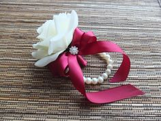 Wrist Corsage, Off White Rose with Burgundy / Wine Color ribbon on pearl bracelet, Christmas Corsage White Roses, Red Roses, Rose Corsage, Corsages, Mother Of Bride Corsage, Best Engagement Gifts, Wedding Hamper, Sola Wood Flowers, Girls Dress Up