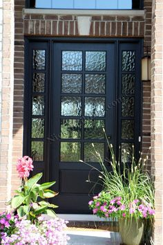 This Beautiful Black Front Door is better then a Fiberglass door. It is a charming classic French Style Door with a twist. This is a Wood Door set up as a Single Exterior Door with Two Side Lites. Instead of a typical clear glass door, they installed non-clear glass in the door. Perfect Door for a Brick House. Door was Purchased at www.nicksbuilding...