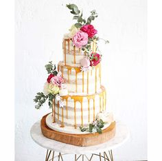 Having a drip wedding cake isn't always about the crazy colours and designs, sometimes the classics trump all and that couldn't be truer in this case. Sweet Bloom Cakes have outdone themselves with another delicious design. The mix of floral embellishment, gold drips and a naked cake body give it everything it needs to win our hearts – and bellies!