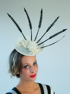 DERBY SPIKE   Black & White Hat Derby Day & Bridal   FORD MILLINERY  $420  The traditional black & white of Derby Day need not be boring when you don a crown of arrows. Nor will the bride- to-be look like all others. Classy and unique, Derby Spike is built on an egshell coloured up-curved sinamay base, hand- decorated with an eggshell sinamay lotus flower, two spiky biot thistle arrangements (also in eggshell) and six black sculpted turkey fishbone feathers. I do. Fascinators, Headpieces, Spring Racing Carnival, Millinery Hats, Derby Day, Eggshell, Lotus Flower, Arrows, Feathers