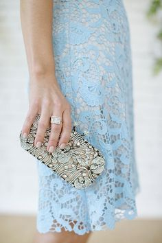 Shop this look on Lookastic:  http://lookastic.com/women/looks/light-blue-lace-sheath-dress-silver-embellished-clutch/8680  — Light Blue Lace Sheath Dress  — Silver Embellished Clutch
