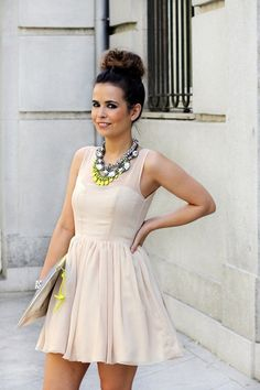 Nude dress, cute bun, and a touch of neon in the jewelry!