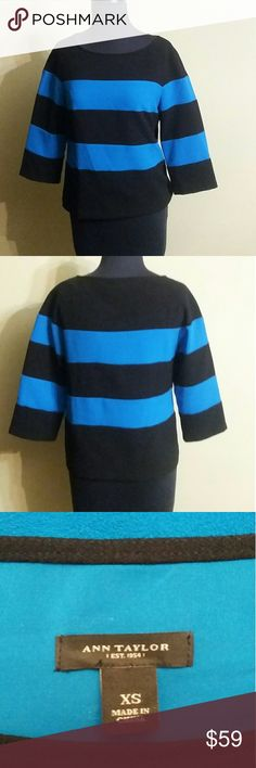 Ann Taylor blouse Turquoise and black stripe blouse. This top is gorgeous and can be warm with black slacks, skirts what turquoise pants if you can find the right shade. I would definitely pair with patent leather heels or purse. This is a great Corporate America tight blouse. It's in great shape! Ann Taylor Tops Blouses