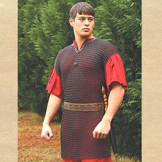 Who said chain mail armor can't be stylish? Not us! The butted rings of our Roman chain mail shirt have been blackened, providing a striking appearance. Weighing in at 18 pounds, this attractive chainmail piece is trimmed in leather at the arms and neck. http://www.pearsonsrenaissanceshoppe.com/roman-mail-shirt.html #chainmail #armor #medieval #larp #larping