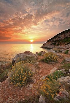 Punta Rossa Beach, Italy - To step lightly over the gravel and prickly bushes on the path leading to the edge of the waters so I can get the best view possible of the splendid sky; whilst dipping my toes in through my flip flops to cool me down for the beginning of the night.
