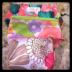 3 Clinique makeup bag bundle 3 new Clinique makeup bags. Never used. Floral print. 3 different sizes.  Bundle for an even better deal! Clinique Makeup Lip Balm & Gloss