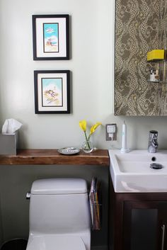 small bathroom space solution - beam over toilet for extra counter space
