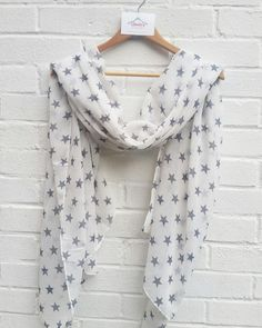 One of my personal favourites, this is a great scarf to see you through every season and is scattered with grey coloured stars.  An ideal scarf for all ages, making it a beautiful gift for a friend...or yourself! It looks amazing with a casual outfit and also dresses up well too.  It's super soft and large enough to wear as a wrap and also makes a great sarong. It's a generous size but lightweight and very comfortable.  All scarves come wrapped in pretty pink tissue.