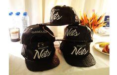 Brooklyn Nets flat caps, worn by Jay Z on WTT Tour