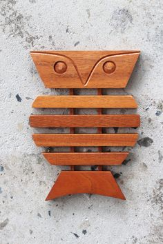 Mid-Century styled wooden owl trivet from the 1960s. Made by Brazilian designer Tullio Bottino. Hand crafted & made of a hard wood. Found in Kentucky.