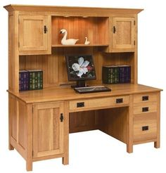 Amish Large Mission Computer Desk with Hutch Top This large desk offers ample workspace and storage. It's not only efficient, but so attractive in solid wood. Custom wood desk built in Amish country. Offers great value as it will never have to be replaced. #wooddesks #desks #largedesk