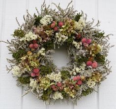 This pretty wreath is about 16-17 in diameter, is made from German Statice, pink gomphrena, white annual statice, green bloom broom and rose tone hydrangea. As with all dried flowers for long lasting life this wreath should be kept out of the direct sunlight. Since my product is perishable it is not returnable. Thank you for visiting my shop