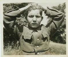Nazi Youngster Plays Soldier.France -- Hands over his head, this youthful Nazi was among the thousands captured by victorious Allies in Cherbourg. Only 16 years old, his boyish face belies the fact that the Nazis have made him a killer capable of brutalities of the oldest and most ruthless followers of Hitler.