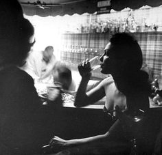 Hollywood glamour girl Eileen Howe having a drink at Samuel Spiegel's New Year's Eve party, Beverly Hills. Photograph by Peter Stackpole.