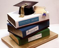Graduation cake...book titles are the schools the grad attended.