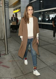 Keeping it casual! Jessica Alba was more dressed down as she jetted into New York City on ...