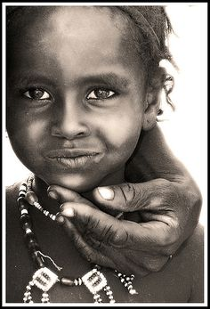 Afar child with the hand of a proud father, Danakil desert, Ethiopia
