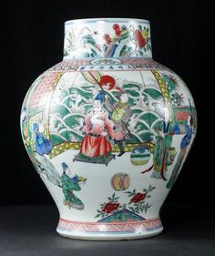 A large Chinese Famille Verte vase. A large Chinese Famille Verte vase. 20th century. Decorated in the Wanli style with Oriental figures in a palace garden with the Emporor depicted within a palace pavilion and enclosed by bands of decoration with six Chinese characters above reading 'Made during the Wanli reign of the Great Ming Dynasty' incorporated above. 13.4 in (34 cm) height.